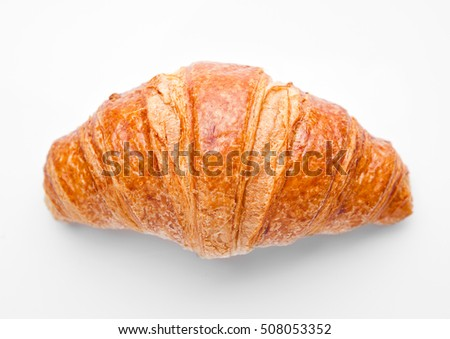 Fresh crispy croissant for breakfast on white background