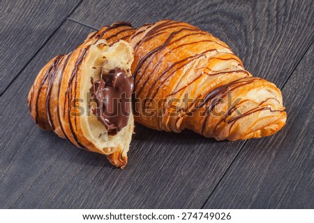 Fresh Croissant on a wooden background - stock photo