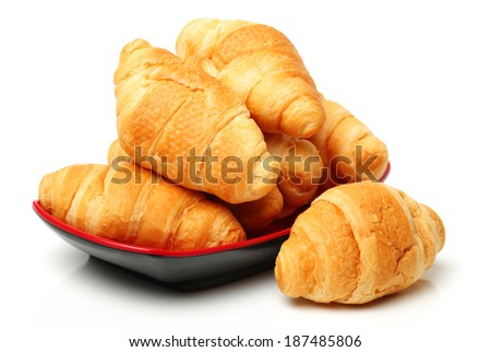 Fresh croissants isolated on white background  - stock photo