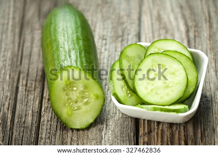 Fresh cucumber on the wooden table - stock photo