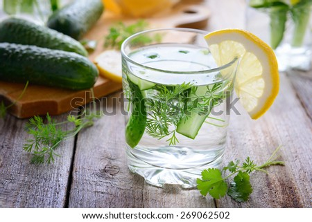 Fresh cucumber water with dill and lemon - stock photo