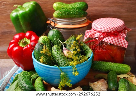 fresh cucumbers and peppers ready for pickles on wooden background  - stock photo