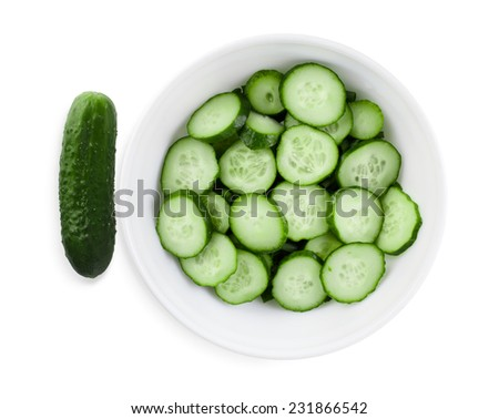 Fresh cucumbers, cut into slices on a white plate. Clipping path.