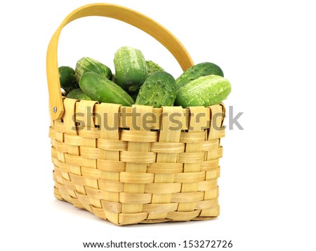 Fresh cucumbers in basket on a white background