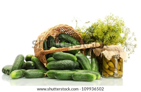 fresh cucumbers, pickles and dill in basket isolated on white - stock photo