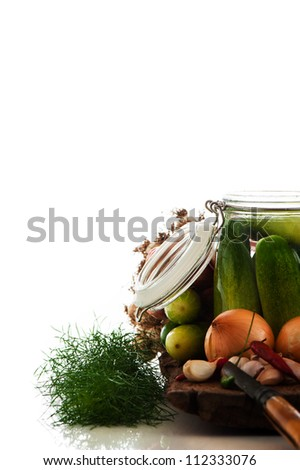 fresh cucumbers prepared for pickling with the chili dill and the garlic. White background - stock photo