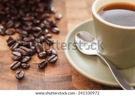 Fresh Cup of Coffee with Coffee Beans - stock photo