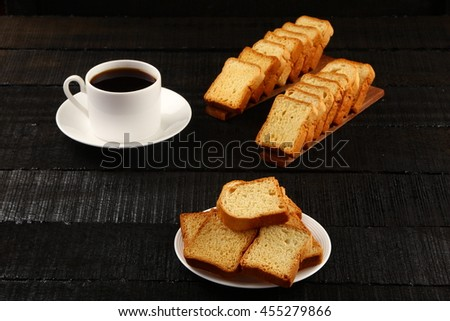 Fresh cup of Organic  black coffee with butter toast cookie. - stock photo