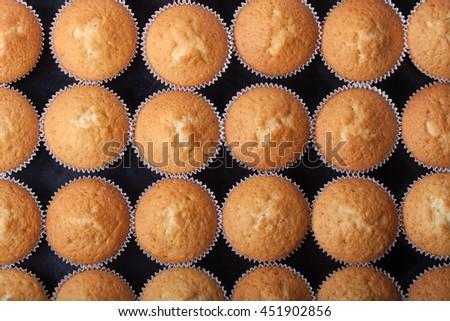 Fresh cupcake desert before decoration. Top view. - stock photo