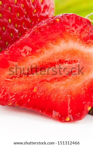 fresh cut strawberry with leaf macro isolated on white