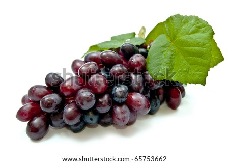 Fresh dark grape with leaves. Isolated on white - stock photo