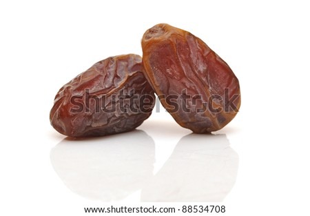 Fresh dates over white background. soft focus - stock photo