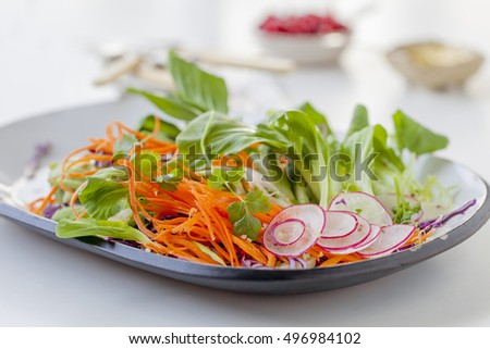 Fresh delicious green salad on a plate