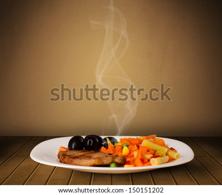 Fresh delicious home cooked food with steam on wood deck - stock photo