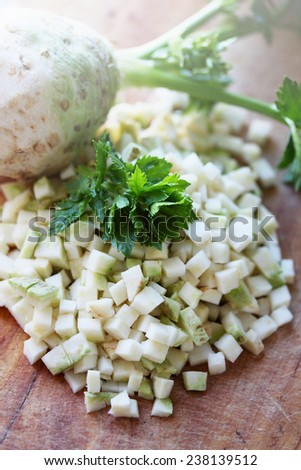 Fresh diced celery on a wooden board - stock photo