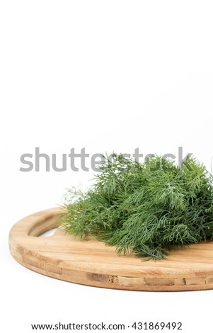Fresh dill on the wooden kitchen board