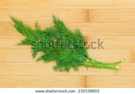 fresh dill on wooden board - stock photo