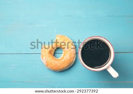 fresh donut with coffee - stock photo