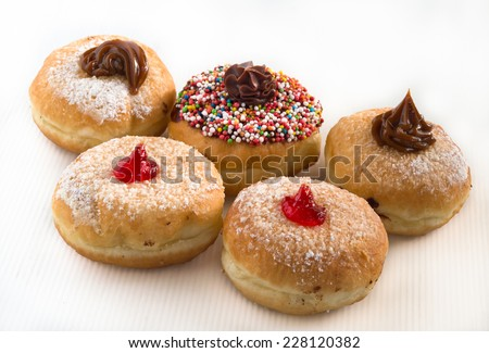 Fresh donuts for Hanukkah celebration. - stock photo