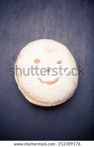 Fresh donuts. Shrove Tuesday. fat Thursday. homemade doughnuts with smiley face - stock photo