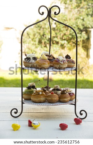 Fresh donuts stand - stock photo