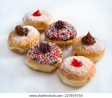 Fresh donuts with jam and chocolate for Hanukkah celebration.