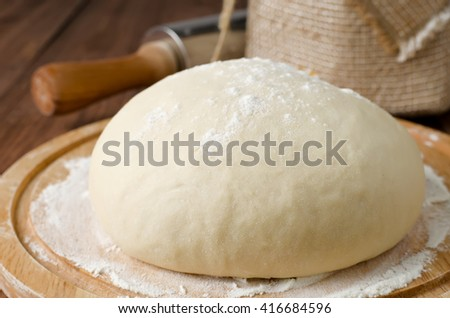 Fresh dough for noodles, ravioli and dumplings. Rustic style. Top view