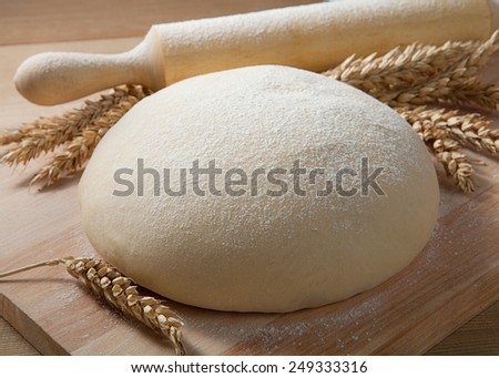 Fresh dough on the table. - stock photo