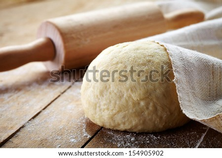 fresh dough ready for baking - stock photo