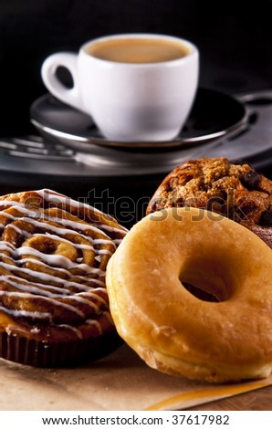 Fresh doughnut and cookies with an espresso - stock photo