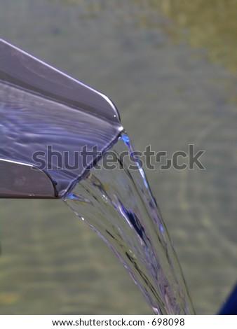 Fresh drinking water flowing free - stock photo