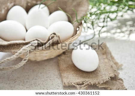 fresh egg in a basket from farm - stock photo