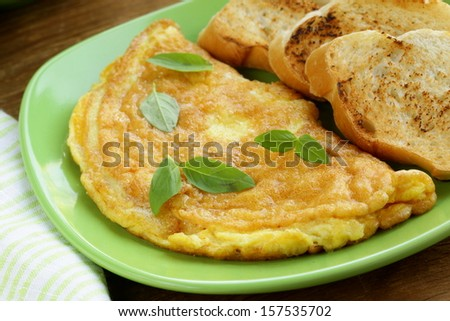 fresh egg omelet with basil for breakfast