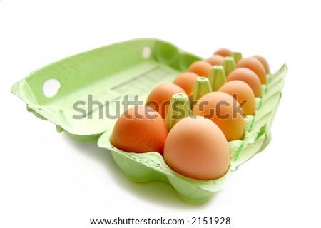 Fresh eggs in carton, isolated over white, macro - stock photo