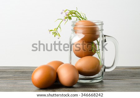 Fresh eggs in the mason jar on wooden background