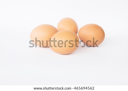 Fresh eggs on a white background