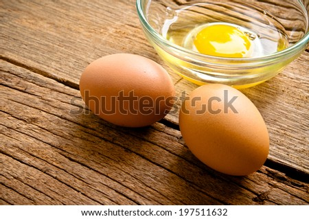 Fresh Eggs With Bowl of Eggs on Wooden Table, Food Rustic Style.