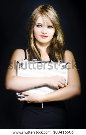 Fresh Faced Female Business Employee Holding Briefcase With A Look Of Uncertainty In A Career Path Options And Business Choices Photograph On Dark Background - stock photo