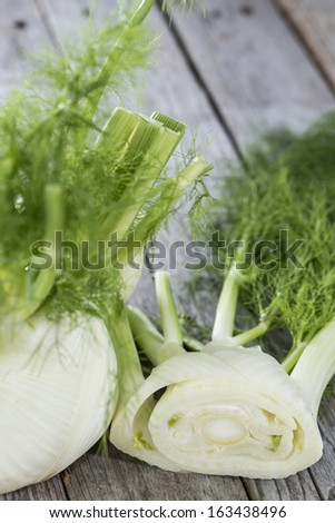 Fresh Fennel on vintage wooden background