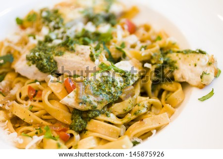 Fresh fettucini with chicken, red peppers, and basil pesto.