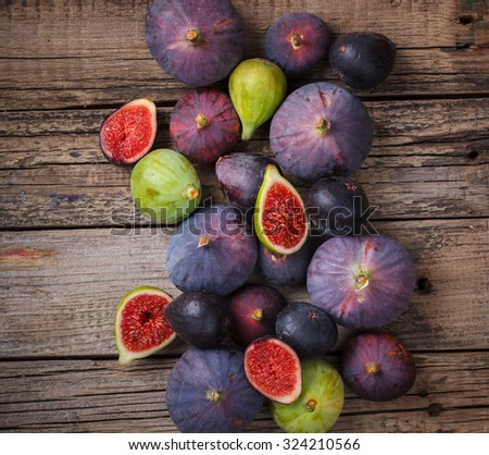 Fresh figs in different grade, vintage wooden Board.selective focus - stock photo