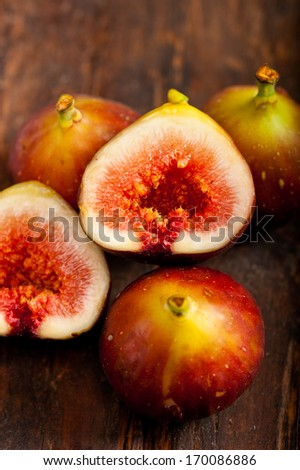 fresh figs macro closeup over old wood boards - stock photo