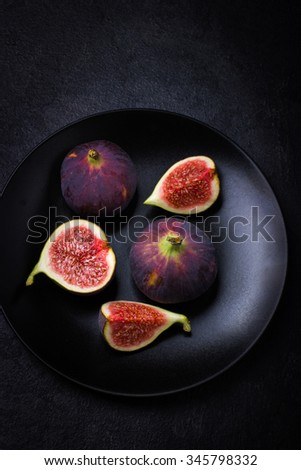 fresh figs on dark background, top view - stock photo
