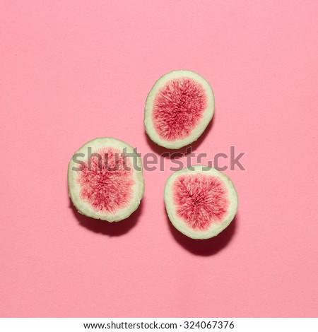 Fresh figs on pink background.Vanilla Fashion Style  - stock photo