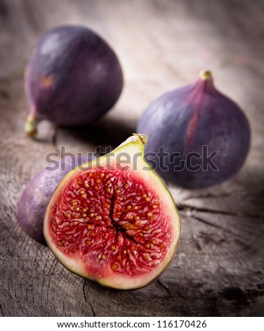 Fresh figs on the wooden table - stock photo
