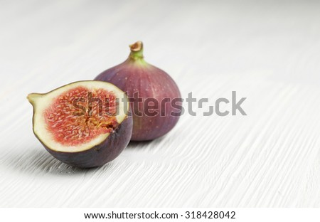 fresh figs on white wooden background - stock photo