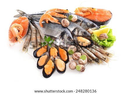Fresh fish and other seafood isolated on white - stock photo