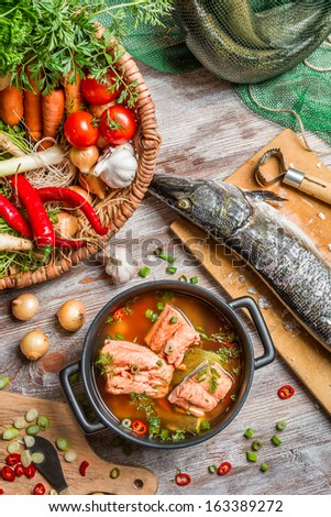 Fresh fish and vegetables for a healthy soup - stock photo