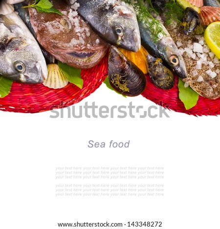 fresh fish bream, monkfish, cod, sole Sprinkle with salt and decorated with leaves and herbs on the red circular woven mats isolated on white background - stock photo