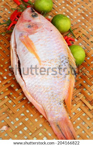 Fresh fish in the basket - for cooking. - stock photo